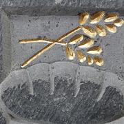 Relief auf einem Pflasterstein